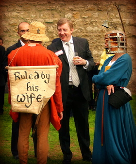medieval performers mingling with corporate guests